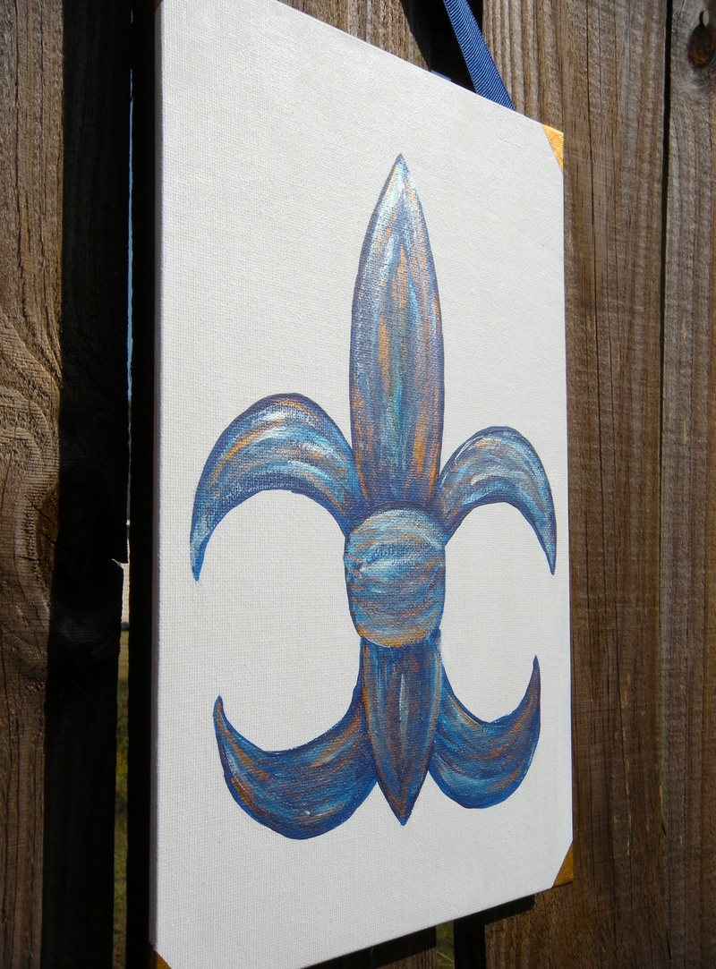 Metallic blue fleur de lis $20- (side view)